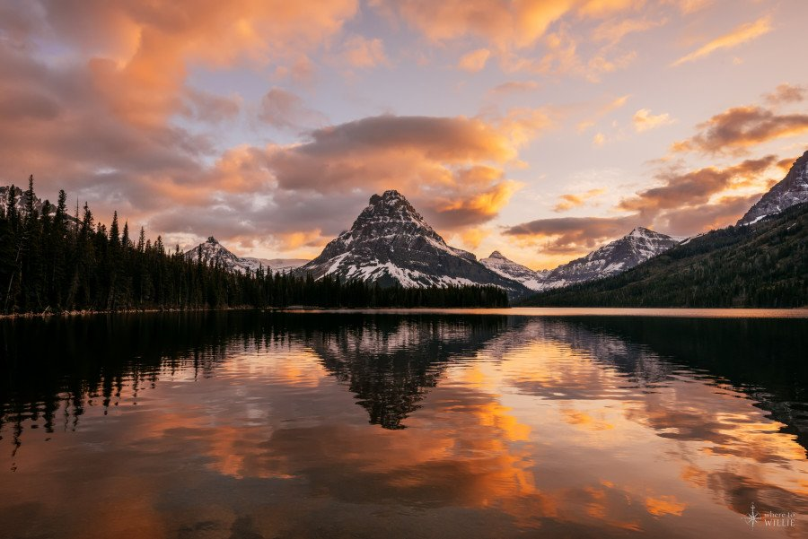 sunset colors two medicine lake glacier national park montana water reflection william woodward